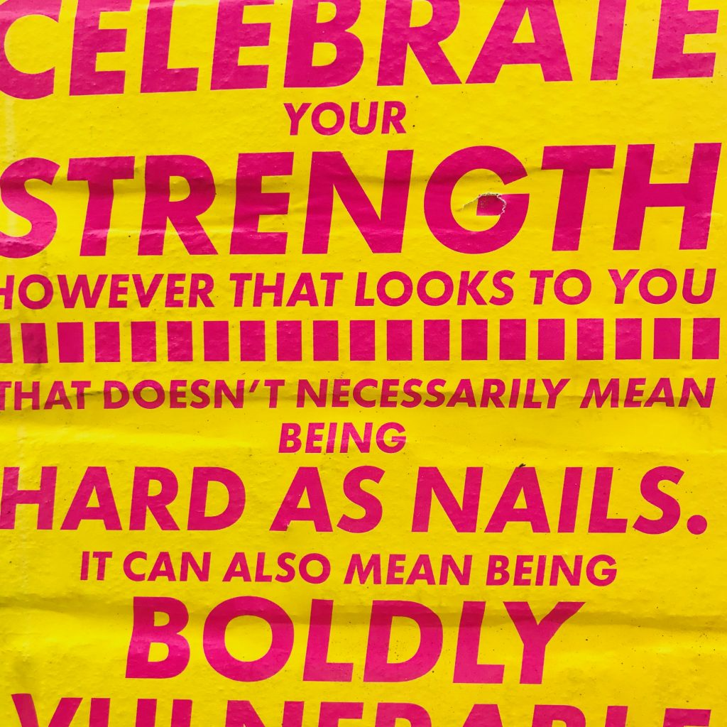 Pink text on yellow poster